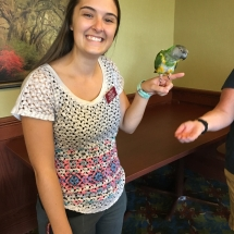 Bird Show-Eagan Pointe Senior Living-Activity Director holding a bird