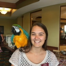 Bird Show-Eagan Pointe Senior Living-Activity Director with big bird on her shoulder