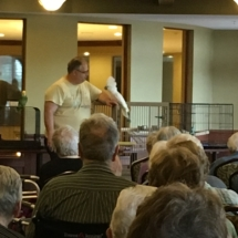 Bird Show-Eagan Pointe Senior Living-Brad teaching the tenants about his parrots