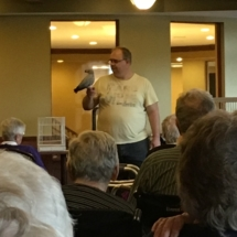 Bird Show-Eagan Pointe Senior Living-Brad with bird perched on his arm