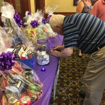 national-night-out-alzheimers-association-fundraiser-eagan-pointe-senior-living-gentleman buying raffle tickets