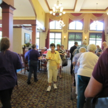 national-night-out-alzheimers-association-fundraiser-eagan-pointe-senior-living-people checking out fundraiser baskets