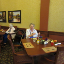 national-night-out-alzheimers-association-fundraiser-eagan-pointe-senior-living-women enjoying her food