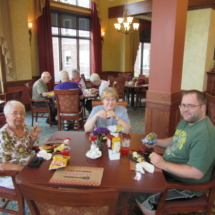 national-night-out-alzheimers-association-fundraiser-eagan-pointe-senior-living-tenants and family enjoying food