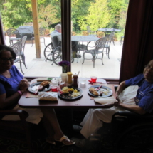 national-night-out-alzheimers-association-fundraiser-eagan-pointe-senior-living-sitting by the window enjoying food