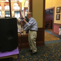 national-night-out-alzheimers-association-fundraiser-eagan-pointe-senior-living-gentleman singing karaoke
