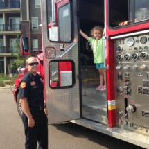 national-night-out-alzheimers-association-fundraiser-eagan-pointe-senior-living-little girl exploring fire truck