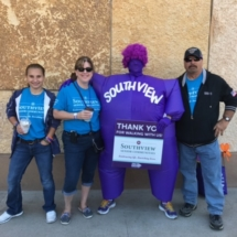 2017 Walk to End Alzheimer's Recap-Eagan Pointe Senior Living-posing with Southview Mascot
