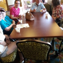 Grandparents Day-Eagan Pointe Senior Living-group hanging out around the table