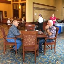 Tenant Appreciation Lunch-Eagan Pointe Senior Living-Men chatting over lunch