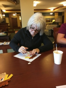 Scarecrow Crafts-Eagan Pointe Senior Living-Getting crafty with her hands
